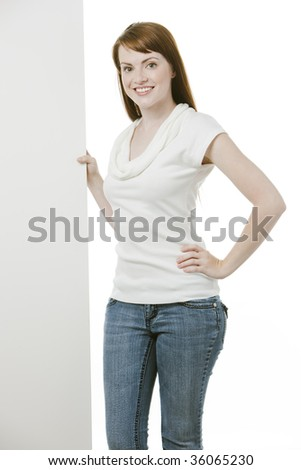 Young female holding a blank board over white