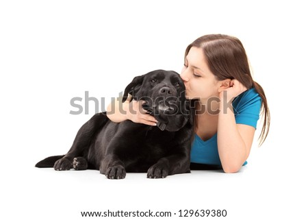Young female hugging and kissing her dog - stock photo