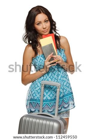 Young female in casual standing with travel bag, holding passport and tickets,isolated on withe background - stock photo