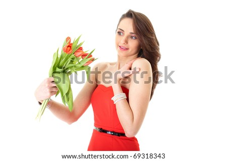 young female in red dress receive bunch of red flowers, isolated on white