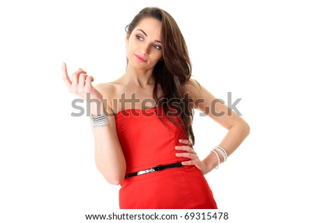 young female in red dress shows 'came here' gesture, studio shoot isolated on white - stock photo