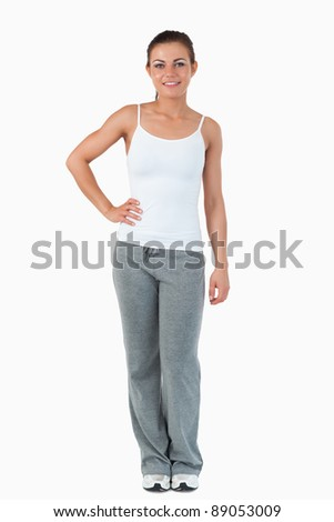 Young female in sports wear against a white background - stock photo