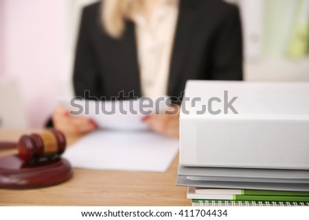 Young female judge working in her office
