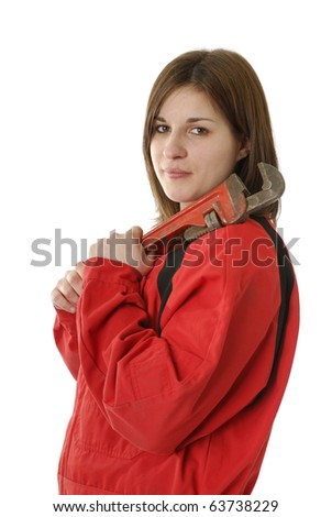 young female manual worker in coverall with crescent wrench