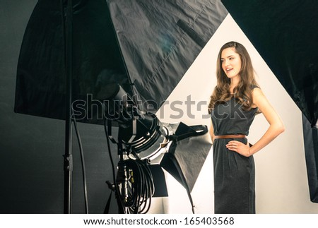 Young female model at photo shooting - stock photo