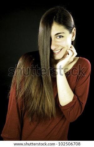 Young female model with amazing straight long hair smiling