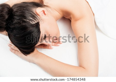 Young female model with beautiful skin, relaxing at the spa after a good session of massage - stock photo