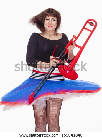 Young Female Musician with Red Trombone Dancing - Isolated on White - stock photo