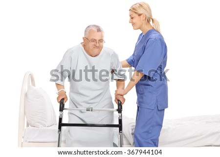 Young female nurse assisting a senior patient with a walker isolated on white background - stock photo