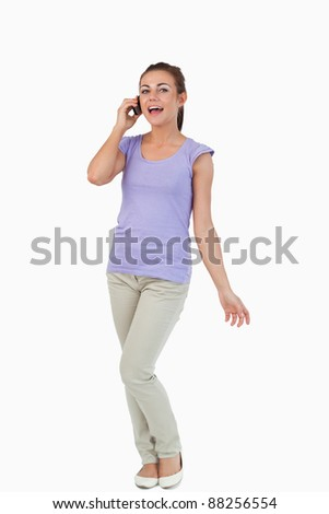Young female on the phone against a white background