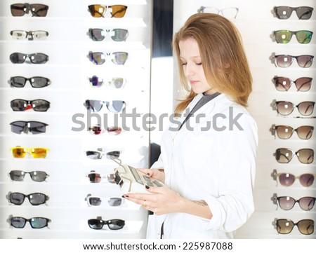 young female optometrist - stock photo