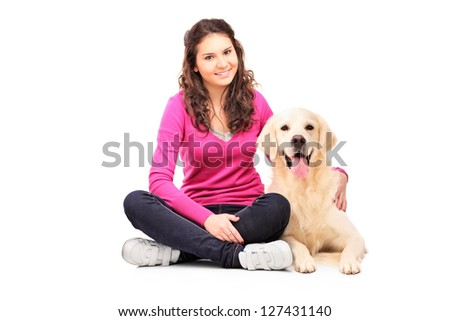 Young female posing with a labrador retriever isolated on white background - stock photo