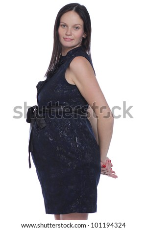 Young female pregnant - happy woman in studio - stock photo