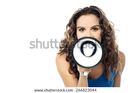 Young female proclaiming into the loudspeaker