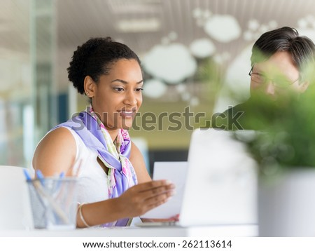 Young female professional in an office