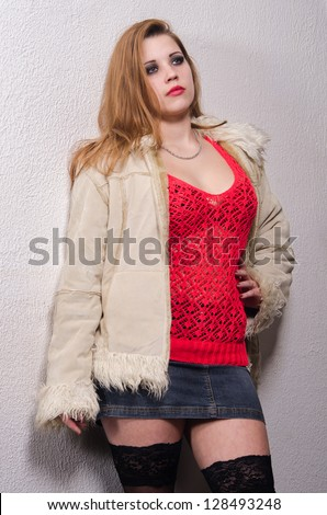 Young female prostitute standing on the street. - stock photo