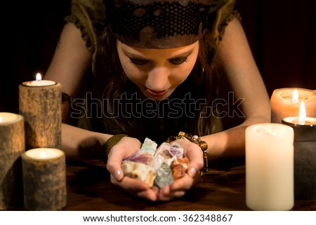 young female psychic with a lots of healing stones