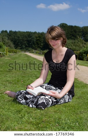 Young female reading a novel
