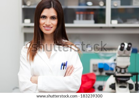 Young female researcher in a modern lab - stock photo