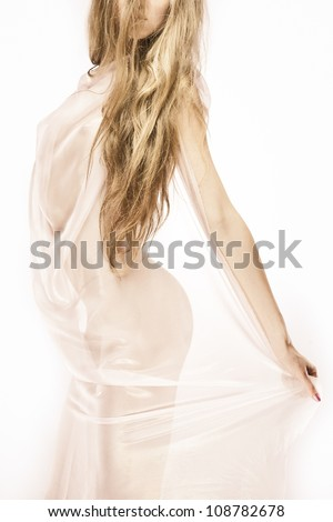 Young female's body with long hair on white