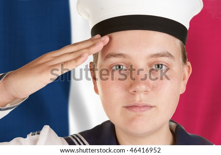 young female sailor saluting in front of french flag - stock photo