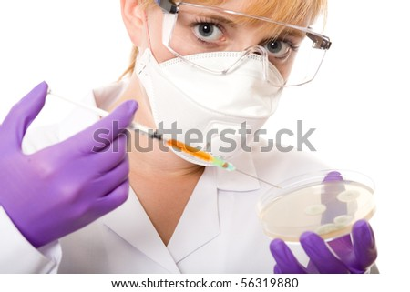 young female scientist with mask and goggles, holds syringe and petri dish, laboratory shoot, isolated on white background