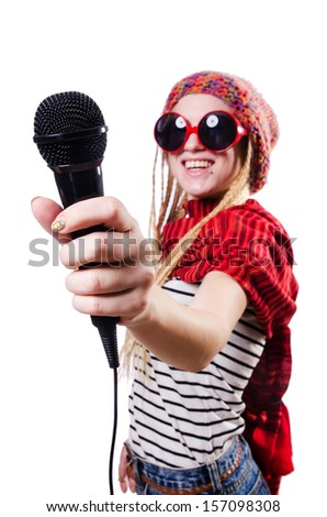 Young female singer with mic on white - stock photo