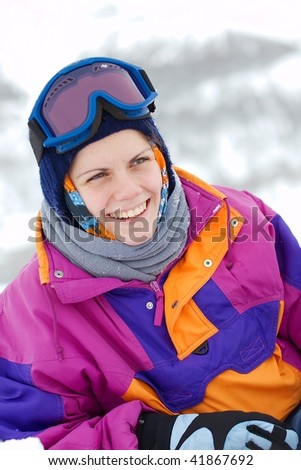 young female skier laughing happily