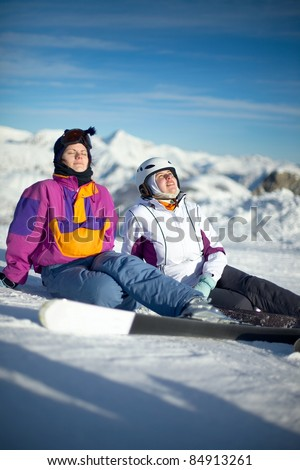 Young female skiers relaxing