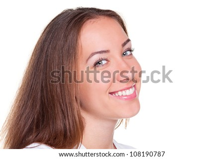 young female smiling and looking at camera over white background
