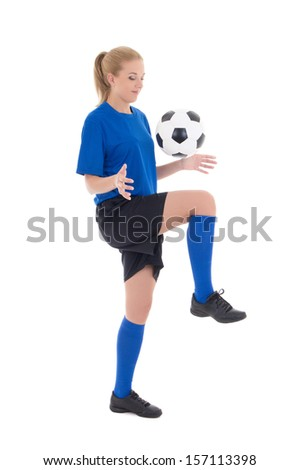 young female soccer player in blue uniform playing with ball isolated on white background