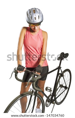 young female sportswoman with old school singlespeed race bike.biker equipped with professional gear, isolated over white. vertical shot