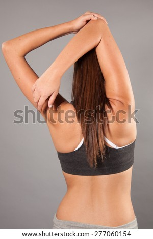 young female stretching back view  - stock photo