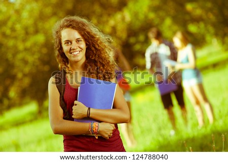 Young Female Student at Park with Other Friends