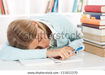 Young female student feel asleep after long learning,Exhausted student - stock photo