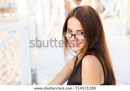Young female student  in reading glasses - stock photo