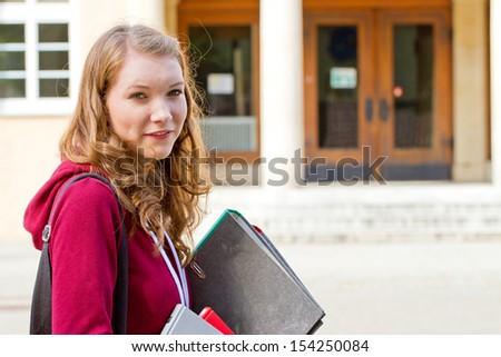 Young, female student on campus - stock photo