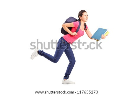Young female student rushing forwards with book in her hand - stock photo