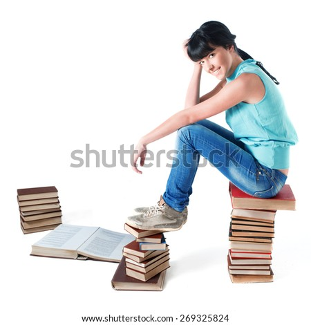 Young female student sitting on her books