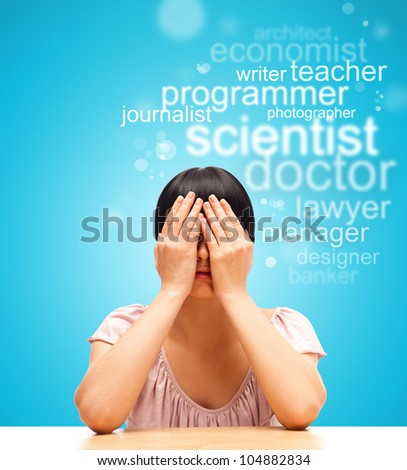 Young female student sitting with face palm and thinking about future profession - stock photo