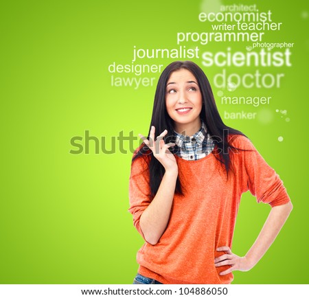 Young female student standing and thinking what profession to choose and start education - stock photo
