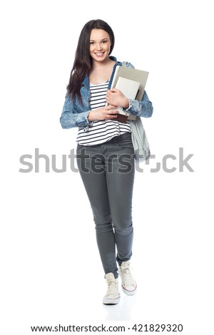 Young female student standing with books and bags, isolated on white