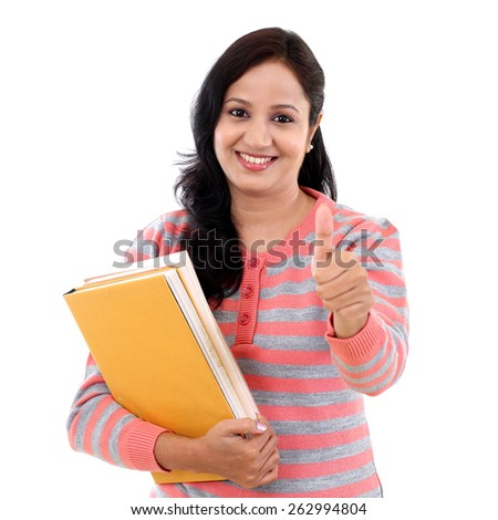 Young female student with thumbs up gesture - stock photo