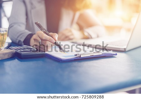 young female student writes information from portable prepare for lectures in University campus,hipster businesswoman working  laptop computer writing business plan while sitting in cafe,vintage color
