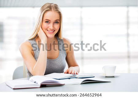 Young female students studying in library - stock photo