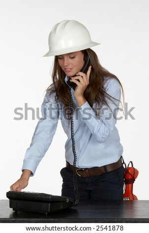 Young Female Telephone Technician Test Phone - stock photo