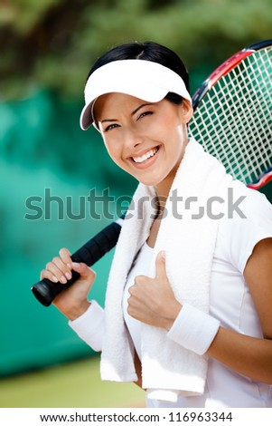 Young female tennis player with towel on her shoulders. Active pastime - stock photo