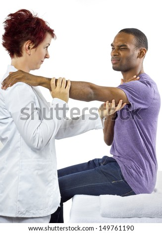 young female therapist helping young male patient  - stock photo