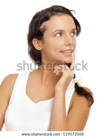 Young female thinking and pondering over something with her finger on the chin - stock photo