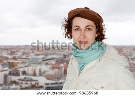 Young female tourist in front of Berlin city panorama in Germany